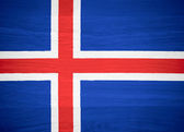 Iceland flag on wood texture — Stock Photo