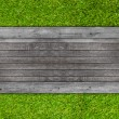 Wood texture on artificial grass background — Stock Photo #45201941