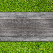 Wood texture on artificial grass background — Stock Photo