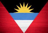 Antigua and Barbuda flag on wood texture — Stock Photo