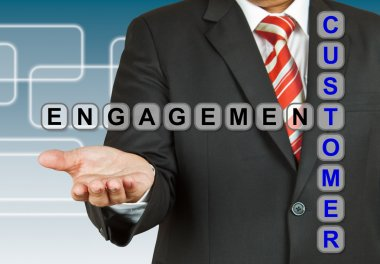 Businessman with wording Customer Engagement