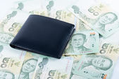 Wallet on most type of Thai baht note display as background — Foto de Stock
