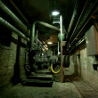 Old abandoned dirty empty scary factory interior - Zdjęcie stockowe