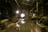 Old abandoned dirty empty scary factory interior — Stock Photo
