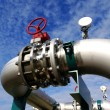 Industrial zone, Steel pipelines and valves against blue sky — Stock Photo