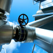 Industrial zone, Steel pipelines and valves against blue sky — Stock Photo #19984987