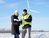 Team og engineers with wind turbines — Stock Photo