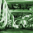 Stock Photo: Industrial zone, Steel pipelines and cables in green tones