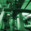 Industrial zone, Steel pipelines and cables in green tones — Stock Photo