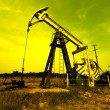 Oil jack against sky — Stock Photo