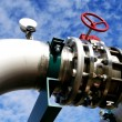 Industrial zone, Steel pipelines and valves against blue sky — Stock Photo #22878040