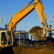 Royalty-Free Stock Photo: Hydraulic excavator at work. Shovel bucket and cranes against bl