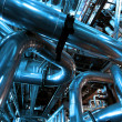 Industrial zone, Steel pipelines and valves in blue tones — Stock Photo