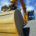 Excavator against blue sky — Stock Photo