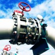 Industrial zone, Steel pipelines and valves against blue sky — Stock Photo #33743765
