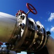 Industrial zone, Steel pipelines and valves against blue sky — Stock Photo #33743771