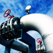 Industrial zone, Steel pipelines and valves against blue sky — Stock Photo #34470549
