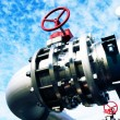 Industrial zone, Steel pipelines and valves against blue sky — Stock Photo #34470557
