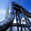 Industrial zone, Steel pipelines and valves against blue sky — Stock Photo #34470699