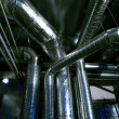 Industrial zone, Steel pipelines and ducts — Stock Photo #38324271
