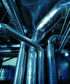 Industrial zone, Steel pipelines and ducts — Stock Photo
