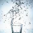 Water splash out of glass — Stock Photo