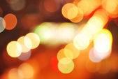Decorative defocused winter lights. Yellow, purple, white, red c — Stock Photo