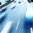 Highway with lots of cars. Blue tint, high contrast and motion b — Stock Photo