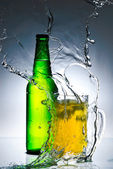 Beer bottle with water splash — Stock Photo