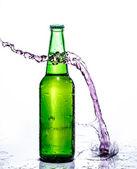 Beer bottle with water splash — Stock Photo
