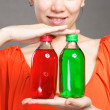 Portrait of woman with bottle of water — Stock Photo #13989763