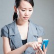 Attractive businesswoman using mobile phone — Stock Photo #14016415