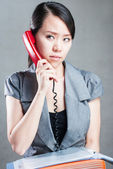 Attractive businesswoman using mobile phone — Stock Photo