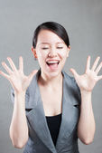 Happy Asian woman with her arms in the air cheering — Stock Photo