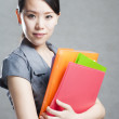 Bright picture of beautiful woman with folders — Stock Photo #14030241