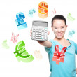 Young Asian women to take a calculator, financial symbols — Stock Photo