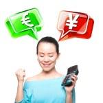 Young Asian women to take a calculator, financial symbols — Stock Photo #14036379