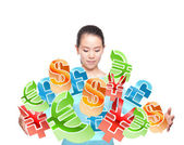 Young women side full of all kinds of money symbols — Stock Photo