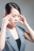 Young woman with head pain on white background — Stock Photo