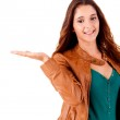 Smiling young woman showing something — Stock Photo