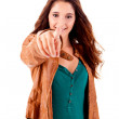 Young beautiful female pointing at copyspace — Stock Photo