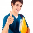 Young happy student showing thumbs up — Stock Photo #17841387