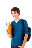 Young happy student carrying books — Stock Photo