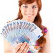 Happy woman showing Euros currency notes - ストック写真