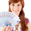 Happy woman showing Euros currency notes - Stockfoto