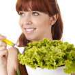 Beautiful woman with lettuce salad — Stock Photo
