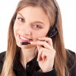 Beautiful call center employee smiling with a headset over white — Stock Photo #18429807
