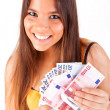 Portrait of a happy woman with a fan of Euros currency notes — Stock Photo #18430127