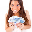 Portrait of a happy woman with a fan of Euros currency notes - ストック写真