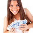 Portrait of a happy woman with a fan of Euros currency notes — Stock Photo #18430259